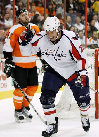 Washington Capitals' Mike Knuble celebrates after scoring against the Flyers. (Associated Press)