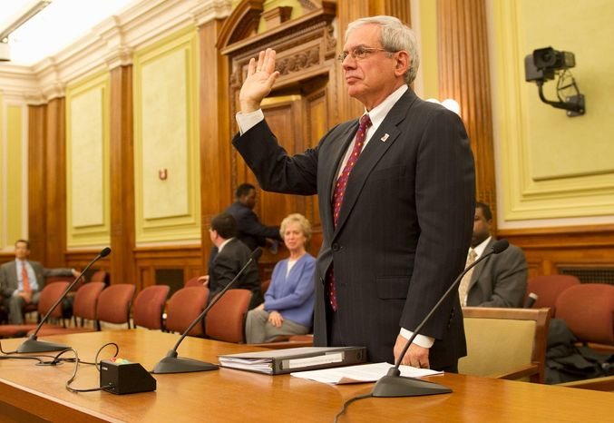 Interim Attorney General Irvin B. Nathan is sworn in prior to his testimony before members of the D.C. Council committee considering his confirmation at a hearing at the Wilson Building in the District on Wednesday. (Rod Lamkey Jr./The Washington Times)