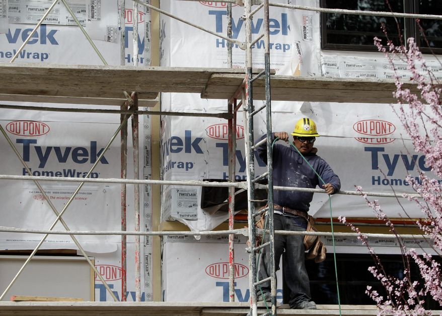 A construction worker gets some electrical power at a housing complex in Palo Alto, Calif. Sales of new homes plunged to record low Wednesday, a dismal sign for an already-weak housing market. Forecasters fear the U.S. economic recovery will be held back if the depressed housing market isn't revitalized soon. (Associated Press)