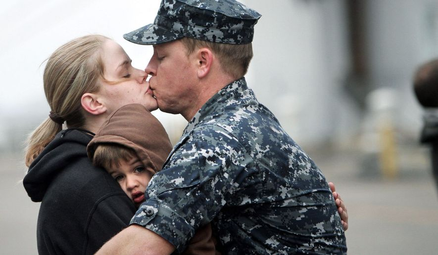 GOODBYE KISS: Petty Officer 3rd Class David Weir kisses his wife, Jessica, and hugs his son, Cody, as he prepares to deploy on the USS Bataan on Wednesday from Naval Station Norfolk. The USS Bataan Amphibious Ready Group is deploying to the Mediterranean Sea to aid international efforts in Libya. The group includes the assault ship USS Bataan, transport dock ship USS Mesa Verde and dock landing ship USS Whidbey Island. (Associated Press)