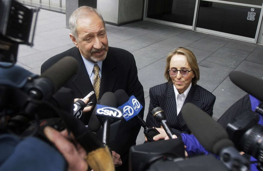 Mark Geragos, left, and Paula Canny, attorneys for Greg Anderson, former trainer of baseball player Barry Bonds, speak to reporters outside of a federal court, Tuesday, March 22, 2011, in San Francisco. (AP Photo/Jeff Chiu)
