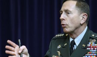 U.S. Army Gen. David H. Petraeus, commander of U.S. and NATO forces in Afghanistan, addresses the Royal United Services Institute in London on Wednesday, March 23, 2011. Gen. Petraeus said foreign troops are on course to complete their security role in Afghanistan by the end of 2014, but he has warned that progress easily could be reversed. (AP Photo/Sang Tan)