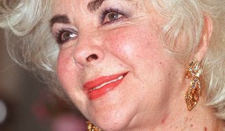 ** FILE ** Elizabeth Taylor, pictured in 1999, died Wednesday at age 79. (AP Photo/Dave Thomson, File)