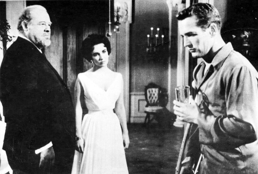 """Elizabeth Taylor starred with Burl Ives (left) and Paul Newman in the 1958 film adaptation of Tennessee Williams' """"Cat on a Hot Tin Roof."""""""