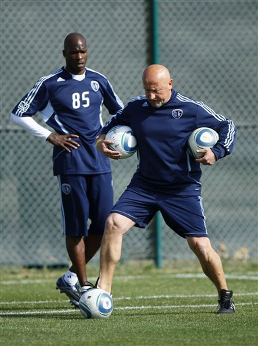 NFL star Chad Ochocinco answers a question from the media as he takes a break during a four-day tryout with the Sporting Kansas City MLS soccer team, Wednesday, March 23, 2011, in Kansas City, Mo. With the NFL in a lockout, Ochocinco, a wide receiver for the Cincinnati Bengals, has said that it is a good time to check into another sport. (AP Photo/Ed Zurga)