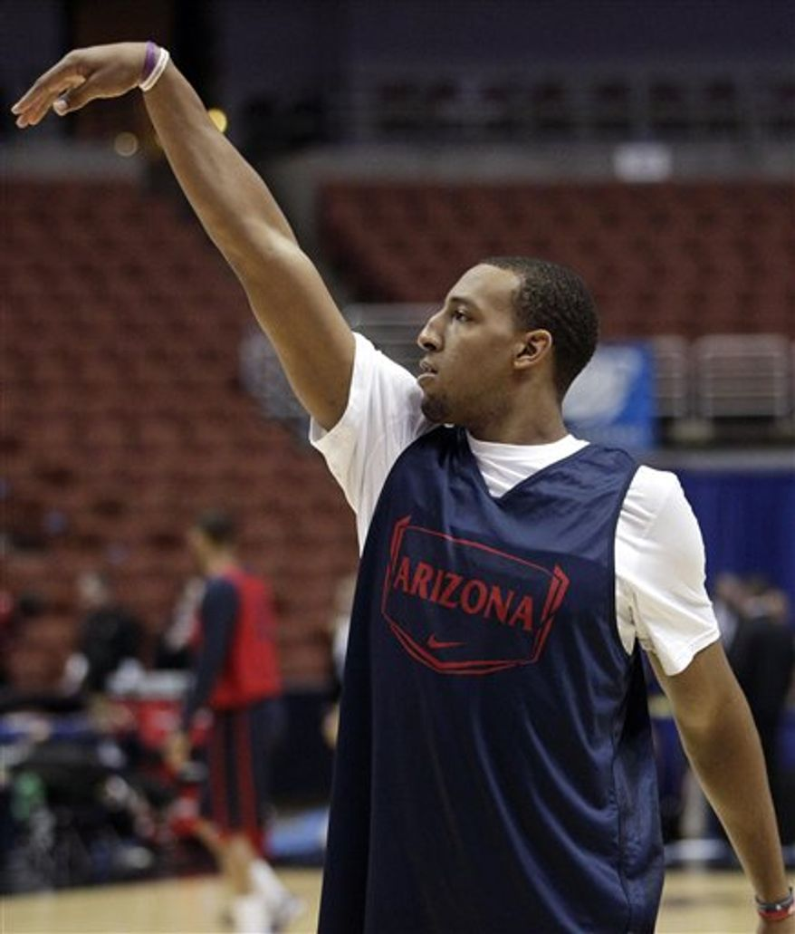 Arizona' Derrick Williams speaks during a news conference for a West regional semifinal game in the NCAA college basketball tournament, Wednesday, March 23, 2011, in Anaheim, Calif. (AP Photo/Mark J. Terrill)