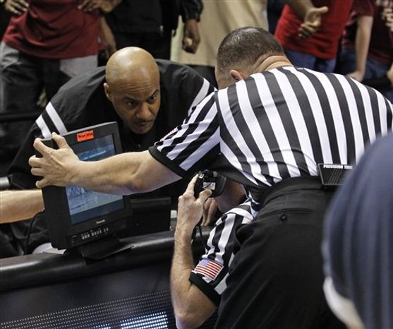 In this Friday, March 11, 2011 photo, an official prepares for play as his automatic timing system remote is seen clipped to his belt during the first half of an NCAA college basketball game at the Southeastern Conference tournament, in Atlanta.  It's an odd situation that caught plenty of prominent coaches off guard when told this week that game clocks in the tournament are not linked to a well-known device known as Precision Time Systems, which was invented nearly two decades ago by former NBA and college referee Michael Costabile. (AP Photo/John Bazemore, File)