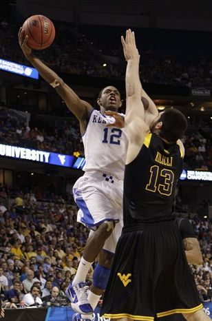 Kentucky's Brandon Knight (12) cheers as his team pulls ahead of West Virginia during the final minutes of the second half in a third-round East regional NCAA tournament college basketball game in Tampa, Fla., Saturday March 19, 2011. (AP Photo/Chris O'Meara)