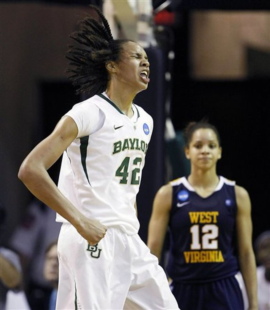 Baylor center Brittney Griner, right, blocks a shot attempt by West Virginia forward Madina Ali (44) in the first half of a second-round game of the NCAA women's college basketball tournament Tuesday, March 22, 2011, in Waco, Texas. (AP Photo/Tony Gutierrez)