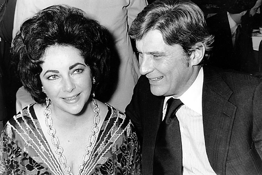 This Jan. 30, 1977 file photo shows actress Elizabeth Taylor and her husband, former secretary of the U.S. Navy John Warner, at the 42nd New York Film Critics Circle Awards dinner in New York. Publicist Sally Morrison says Taylor died Wednesday, March 23, 2011 in Los Angeles of congestive heart failure at age 79. (AP Photo/File)