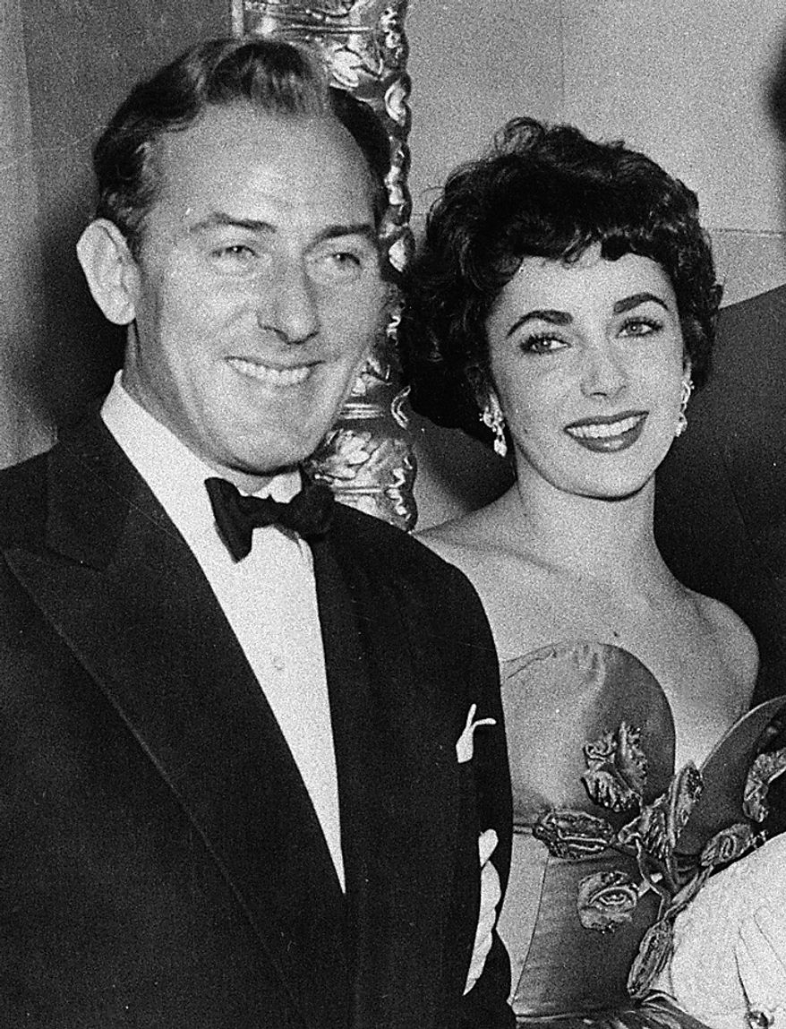 This 1951 file photo shows actress Elizabeth Taylor with actor Michael Wilding. Publicist Sally Morrison says Taylor died Wednesday, March 23, 2011 in Los Angeles of congestive heart failure at age 79. (AP Photo/File)