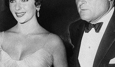 In this 1957 file photo, actress Elizabeth Taylor is shown with her husband Mike Todd. Publicist Sally Morrison says Taylor died Wednesday, March 23, 2011 in Los Angeles of congestive heart failure at age 79. (AP Photo/File)