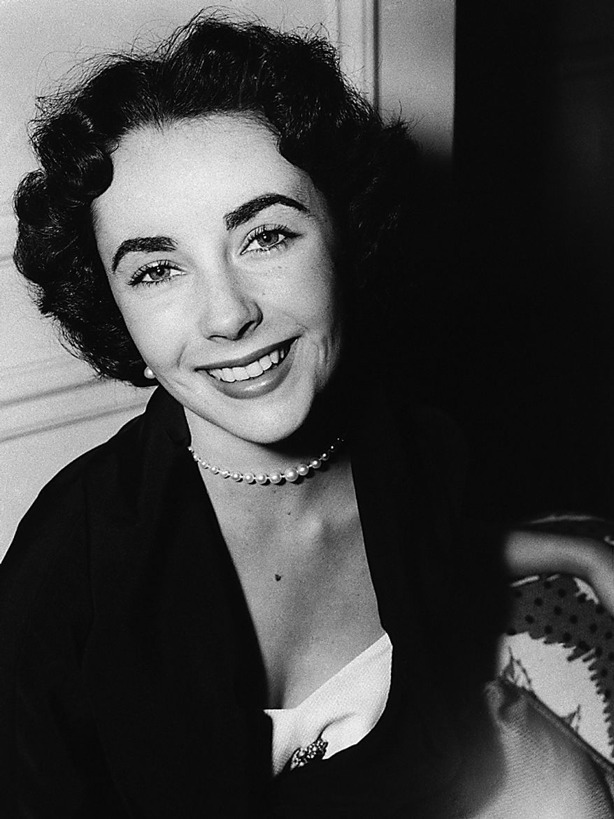 In a June 10, 1950 file photo, actress Elizabeth Taylor is shown on her arrival from Paris to London, at the Savoy Hotel.  Publicist Sally Morrison says the actress died Wednesday, March 23, 2011 in Los Angeles of congestive heart failure at age 79. (AP Photo/File)