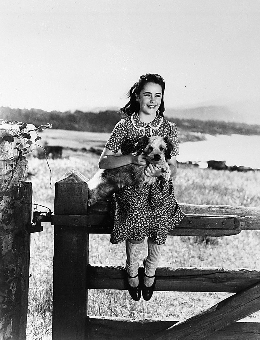 """In a 1944 file photo, young actress Elizabeth Taylor is seen during the time that she was filming """"National Velvet"""". Publicist Sally Morrison says the actress died Wednesday, March 23, 2011 in Los Angeles of congestive heart failure at age 79. (AP Photo/File)"""