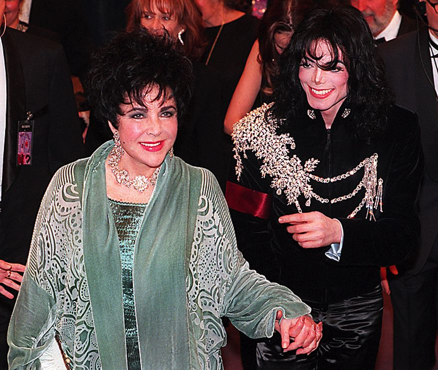 This Feb. 16, 1997 file photo shows Elizabeth Taylor arriving with Michael Jackson at the Pantages Theater in Los Angeles for her birthday celebration. Publicist Sally Morrison says the actress died Wednesday, March 23, 2011 in Los Angeles of congestive heart failure at age 79. (AP Photo/Chris Pizzello, File)