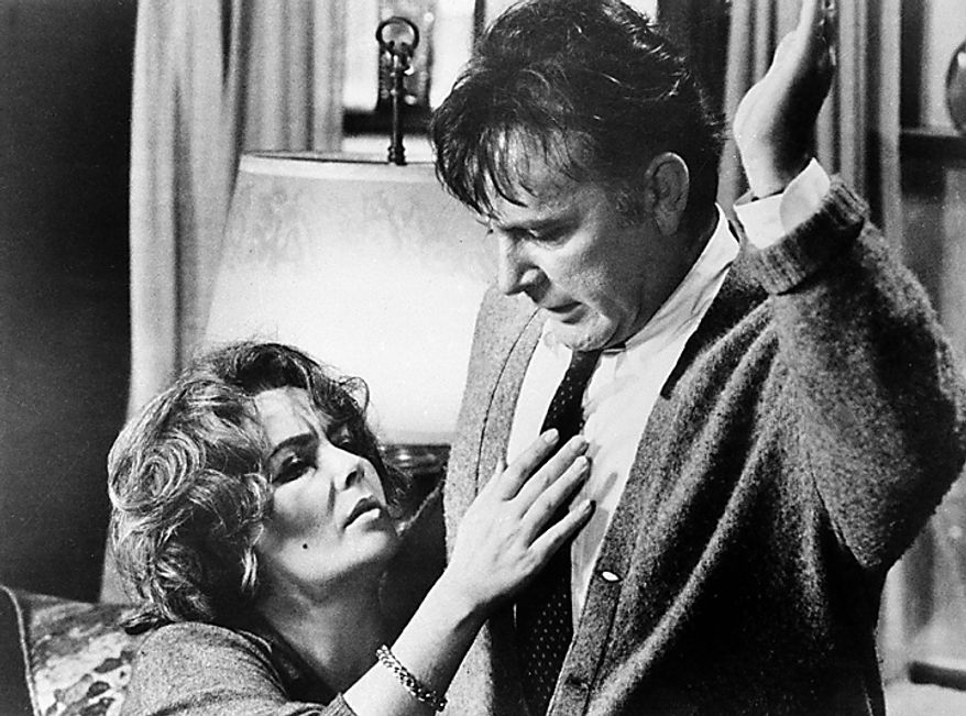 """This 1966 file photo shows Elizabeth Taylor in the role of Martha, and Richard Burton in the role of George in a scene from the 1966 movie """"Who's Afraid of Virginia Woolf?"""" Publicist Sally Morrison says Taylor died Wednesday, March 23, 2011 in Los Angeles of congestive heart failure at age 79. (AP Photo/File)"""