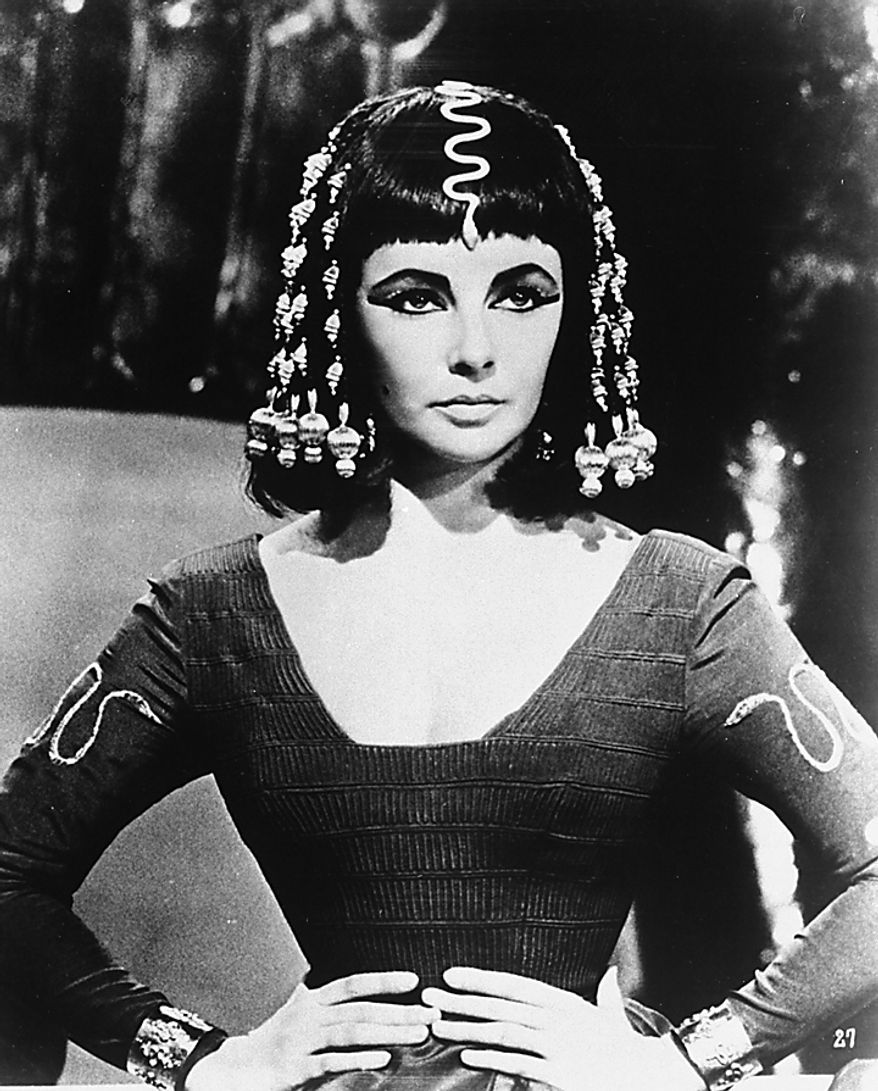 """Actress Elizabeth Taylor poses as Queen Cleopatra in this photo from Joseph L. Mankiewiez' 1963 film, """"Cleopatra"""". Elizabeth Taylor, the violet-eyed film goddess whose sultry screen persona, stormy personal life and enduring fame and glamour made her one of the last of the old-fashioned movie stars and a template for the modern celebrity, died Wednesday, March 23, 2011 at age 79. (AP Photo/File)"""