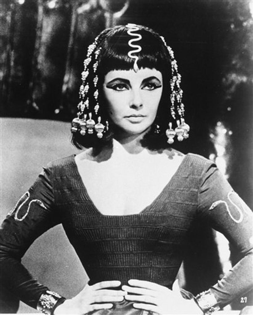 "FILE - Actress Elizabeth Taylor poses as Queen Cleopatra in this photo from Joseph L. Mankiewiez' 1963 film, ""Cleopatra"". Elizabeth Taylor, the violet-eyed film goddess whose sultry screen persona, stormy personal life and enduring fame and glamour made her one of the last of the old-fashioned movie stars and a template for the modern celebrity, died Wednesday, March 23, 2011 at age 79. (AP Photo/File)"