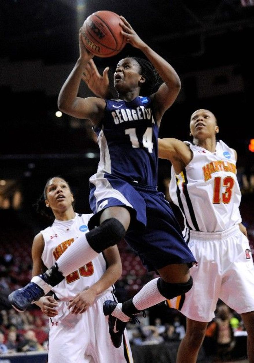 Georgetown's Sugar Rodgers shoots as Maryland's Alicia DeVaugh (right) and Alyssa Thomas defend in an NCAA women's college basketball tournament game Tuesday in College Park, Md. Georgetown won and next faces top seed Connecticut. (Associated Press)