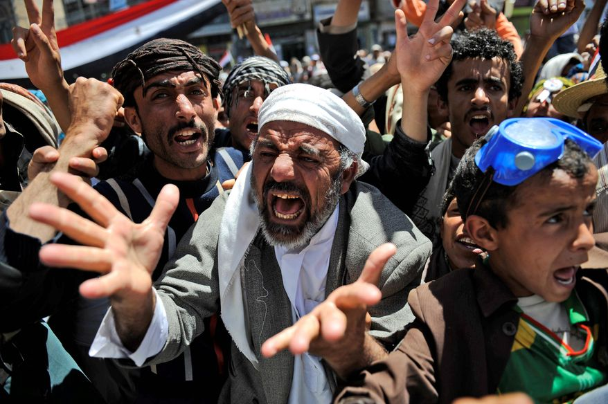 An anti-government protester makes his feelings known Thursday in Sanaa. The leader of Yemen's largest tribe has announced his support for opposition demands that the country's longtime president step down. (Associated Press)