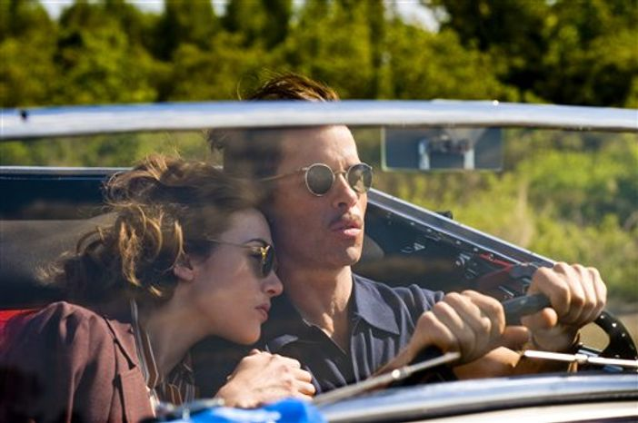 """In this publicity image released by HBO, Kate Winslet,left, and Guy Pearce are shown in a scene from the HBO mini-series, """"Mildred Pierce."""" (AP Photo/HBO, Andrew Schwartz)"""