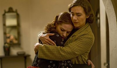 "In this publicity image released by HBO, Evan Rachel Wood, left, and Kate Winslet are shown in a scene from the HBO mini-series, ""Mildred Pierce."" (AP Photo/HBO, Andrew Schwartz)"