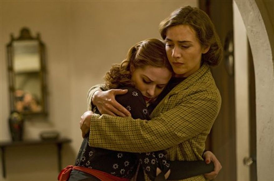 """In this publicity image released by HBO, Evan Rachel Wood, left, and Kate Winslet are shown in a scene from the HBO mini-series, """"Mildred Pierce."""" (AP Photo/HBO, Andrew Schwartz)"""