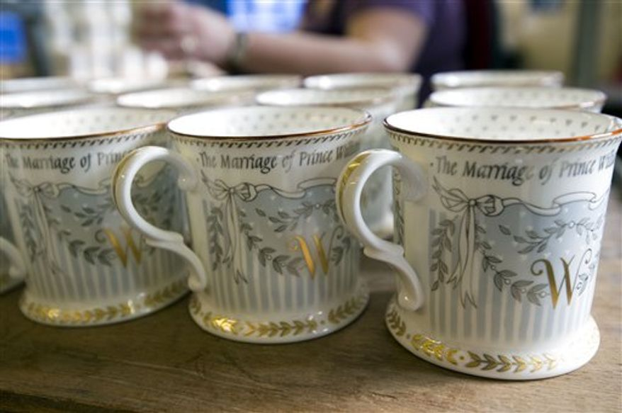 A limited edition of commemorative cups is being finished, as part of a limited edition of Official Royal Wedding Commemorative China collection.  Official pottery commemorating the royal wedding between Britain's HRH Prince William and Catherine Middleton, is being hand finished at a factory in Stoke-on-Trent, England, Wednesday March 23, 2011.  The official commemorative fine china, named The Royal Collection,  including various designs of cups, pill boxes and plates is being completed for the royal wedding on April 29, 2011.(AP Photo)