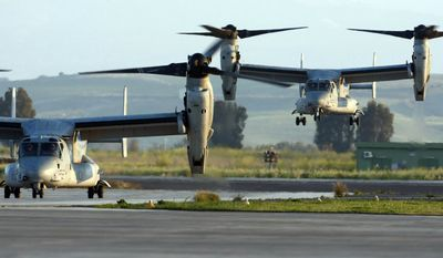 Two MV-22 Osprey vertical-takeoff-and-lift aircraft land, one carrying U.S. Army Gen. Carter Ham, commander of the U.S. military mission in Libya, at the Sigonella air base on the Italian island of Sicily on Thursday, March 24, 2011. (AP Photo/Andrew Medichini)