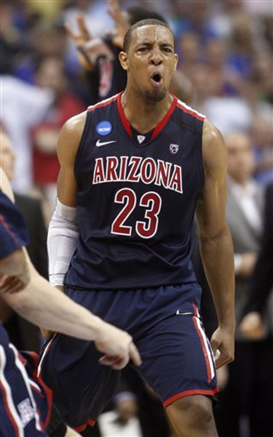 Arizona's Derrick Williams, second from left, is embraced by Jordin Mayes after defeating Texas 70-69 at a West Regional NCAA tournament third-round college basketball game on Sunday, March 20, 2011, in Tulsa, Okla. (AP Photo/Sue Ogrocki)