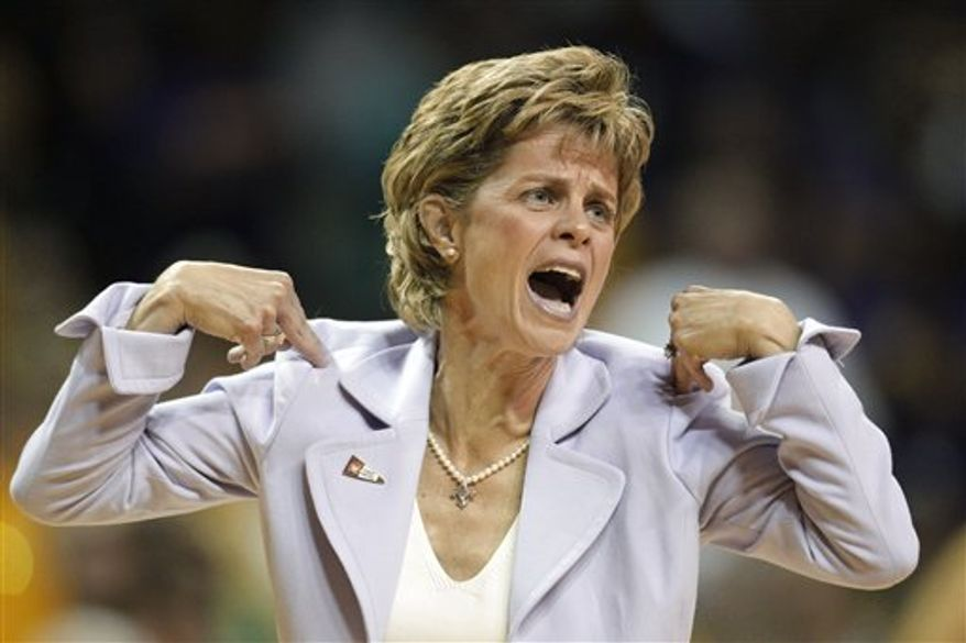 Baylor coach Kim Mulkey calls for a timeout as she reacts to play in the first half of a first-round game of the NCAA women's college basketball tournament game against Prairie View A&M on Sunday, March 20, 2011, in Waco, Texas. (AP Photo/Tony Gutierrez)