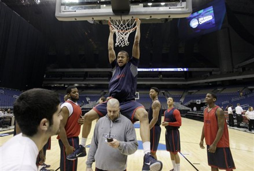 Richmond head coach Chris Mooney watches his team during a practice for a Southwest regional semifinal game in the NCAA college basketball tournament Thursday March 24, 2011, in San Antonio. Richmond plays Kansas Friday. (AP Photo/Eric Gay)