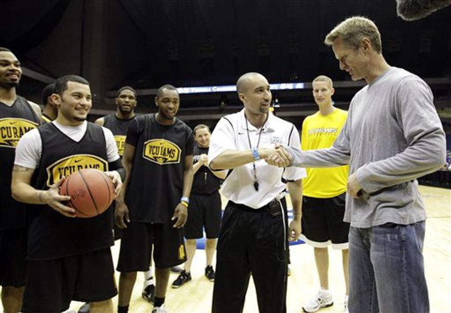 VCU head coach Shaka Smart calls over former NBA player Steve Kerr to join the team during a practice for a Southwest regional semifinal game in the NCAA college basketball tournament Thursday March 24, 2011, in San Antonio. VCU plays Florida St. on Friday. (AP Photo/Eric Gay)