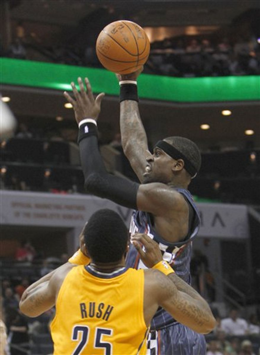 Charlotte Bobcats' Stephen Jackson, top, shoots over Indiana Pacers' Brandon Rush in the first half of an NBA basketball game in Charlotte, N.C., Wednesday, March 23, 2011. (AP Photo/Chuck Burton)
