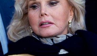 FILE - In this Jan. 27, 1993 file photo, actress Zsa Zsa Gabor is shown in Midland, Texas. Gabor's publicist says the shock of Elizabeth Taylor's death made Gabor fear she was next and sent her to the hospital with high blood pressure. John Blanchette says the 94-year-old celebrity was watching the news Wednesday morning, March 23, 2011 at her Los Angeles home when she learned her friend and one-time neighbor had died. (AP Photo/Curt Wilcott, File)