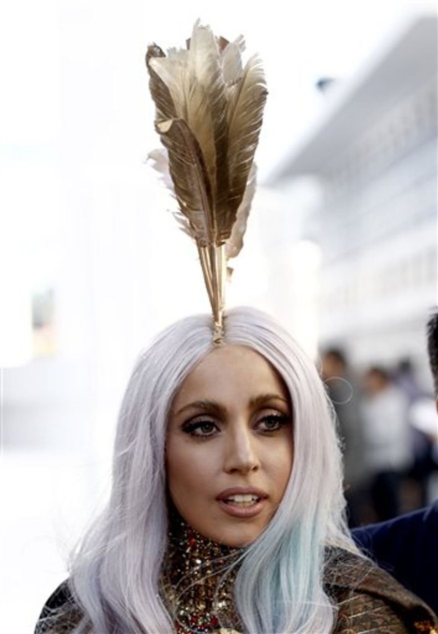 """In a Sept. 12, 2011 photo Lady Gaga arrives at the MTV Video Music Awards in Los Angeles. Lady Gaga said Tuesday March 23, 2011 that young Malaysians who want to hear her song in full on the radio """"must do everything that you can if you want to be liberated by your society.""""  (AP Photo/Matt Sayles)"""