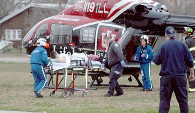 A student is wheeled to a waiting Lifeline helicopter Friday, March 25, 2011, at West Middle School in Martinsville, Ind. A person was shot Friday at the middle school in south-central Indiana and a suspect is in custody, state police said. (AP Photo/Mooresville-Decatur Times, Keith Rhoades)
