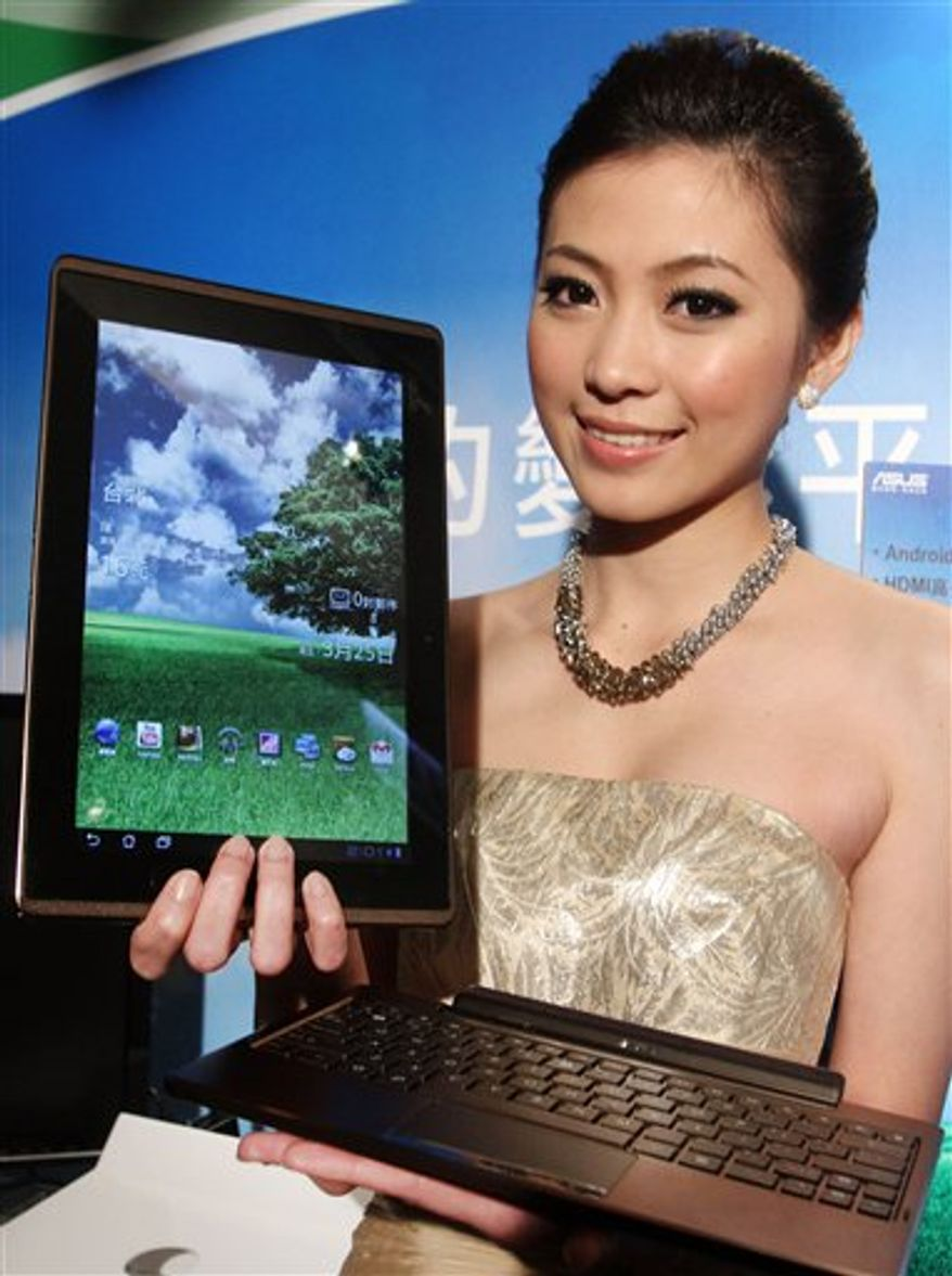 Jerry Shen, CEO of Asus, introduces the Asus Eee Pad Transformer during its new product media event, Friday, March 25, 2011, in Taipei, Taiwan. The Asus Eee Pad Transformer features a 10.1-inch touch screen, tablet with a detachable keyboard dock. It will go on the Taiwanese market at a price of NT$17,999 (US$ 611) for the 16GB model and NT$19,999 (US$ 679) for the 32GB model. (AP Photo/Chiang Ying-ying)