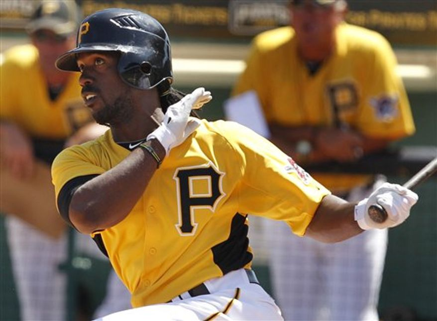 Pittsburgh Pirates' Andrew McCutchen hits a two-run home run off Houston Astros pitcher J.A. Happ in the first inning of a spring training baseball game in Bradenton, Fla., Wednesday, March 23, 2011. (AP Photo/Gene J. Puskar)