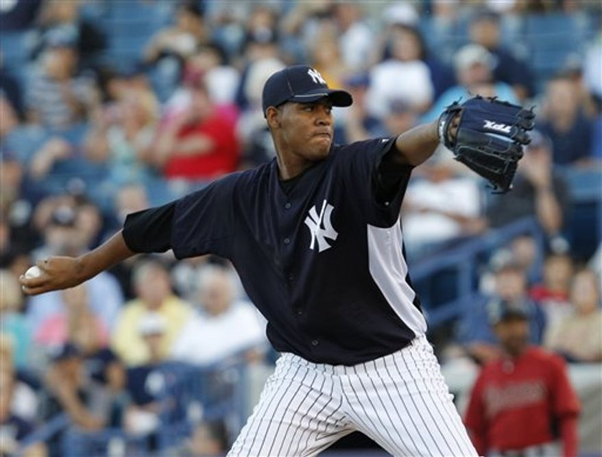 New York Yankees starting pitcher Ivan Nova winds up against the Houston Astros in the Yankees 6-4 victory over the Astros in their spring training baseball game at Steinbrenner Field in Tampa, Fla., Friday, March 25, 2011.  (AP Photo/Kathy Willens)