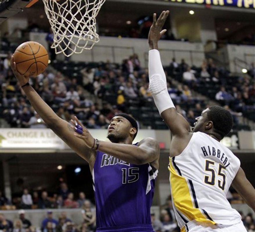 Sacramento Kings forward DeMarcus Cousins, left, shoots in front of Indiana Pacers center Roy Hibbert  in the second half an NBA basketball game in Indianapolis, Friday, March 25, 2011. The Kings won 110-93. (AP Photo/AJ Mast)