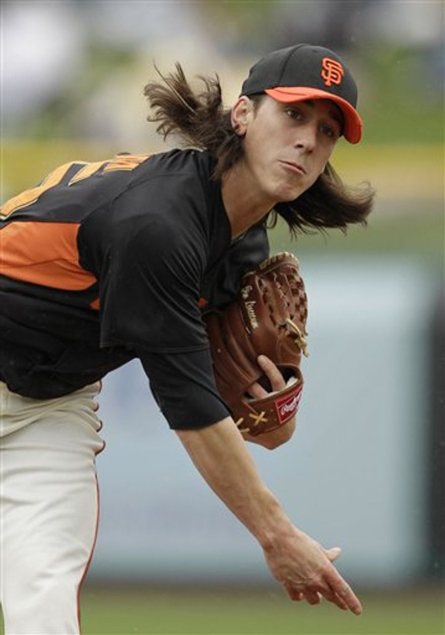 San Francisco Giants starting pitcher Tim Lincecum throws against the Colorado Rockies during the first inning of their spring training baseball game in Scottsdale, Ariz., Monday, March 21, 2011. The game was called in the third inning because of rain with the Rockies leading 5-0. (AP Photo/Eric Risberg)
