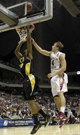 Virginia Commonwealth's Bradford Burgess makes the winning shot as Florida State's Deividas Dulkys defends during the overtime at a Southwest regional semifinal game in the NCAA college basketball tournament Friday, March 25, 2011, in San Antonio. VCU won 72-71. (AP Photo/Tony Gutierrez)