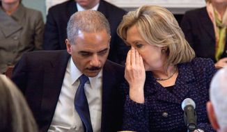 "Secretary of State Hillary Rodham Clinton talks with U.S. Attorney General Eric H. Holder Jr. during a meeting last month of the President's Interagency Task Force on human trafficking. ""Human trafficking has become big business,"" says Mr. Holder. (Associated Press)"