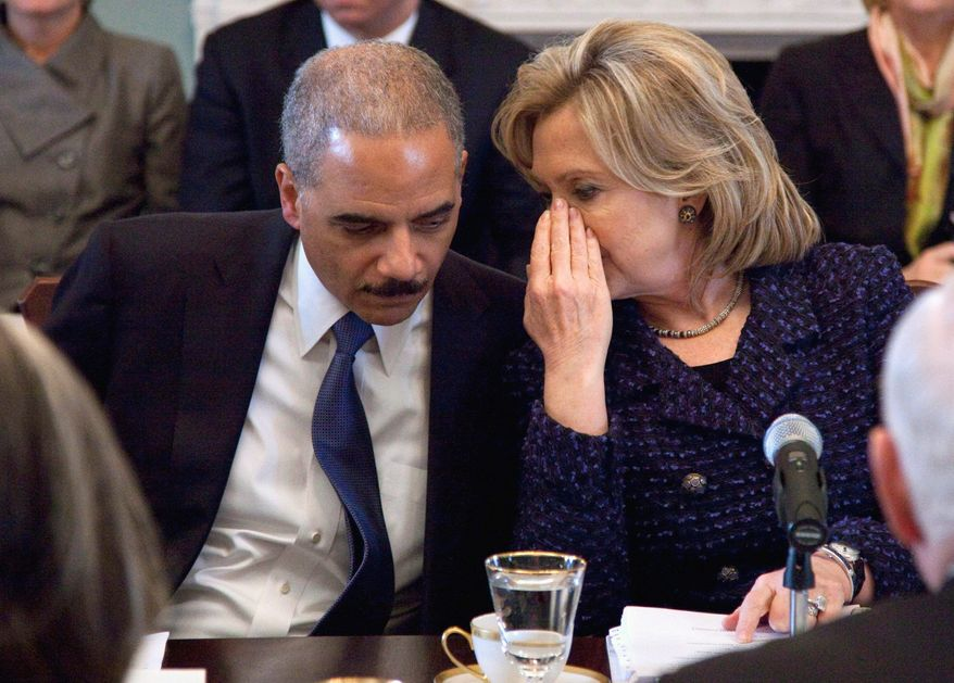 """Secretary of State Hillary Rodham Clinton talks with U.S. Attorney General Eric H. Holder Jr. during a meeting last month of the President's Interagency Task Force on human trafficking. """"Human trafficking has become big business,"""" says Mr. Holder. (Associated Press)"""