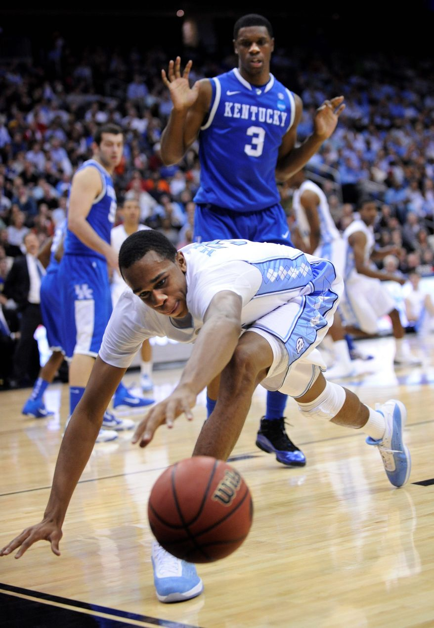 North Carolina's John Henson tries to chase down a loose ball as Kentucky's Terrence Jones (3) looks on during the first half of the final of the NCAA men's college basketball tournament East Regional on Sunday in Newark, N.J. (Associated Press)