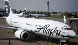 ** FILE ** An Alaska Airlines Boeing 737 is pushed back from a gate at Seattle-Tacoma International Airport in Washington state in June 2009. (AP Photo/David Zalubowski, File)