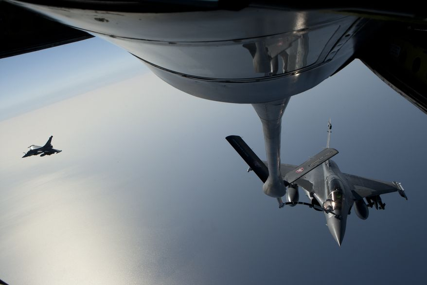 In this Sunday, March 27, 2011, photo provided by the French army, a French navy Rafale is refuelled in the air over the Mediterranean Sea. (AP Photo/Adj. Nicolas-Nelson Richard)