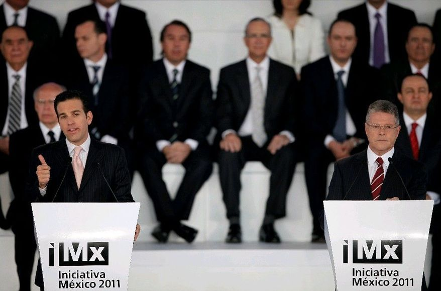 Journalists Carlos Loret de Mola (left) and Sergio Sarmiento speak at Mexico Initiative 2011 in Mexico City last Thursday. Most of Mexico's largest news media outlets agreed to a set of drug-war reporting guidelines, promising not to glorify drug traffickers, publish cartel propaganda messages or reveal information that could endanger police operations.