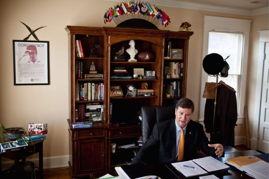 """We have a government that seems to be against us. Nobody's cheering for anything coming out of Washington,"" said Republican George Allen, who is seeking to return to the U.S. Senate. He works out of an office in Alexandria. (Drew Angerer/The Washington Times)"